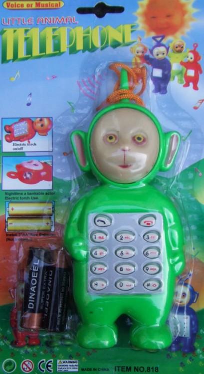 juguete de un celular con la figura de un teletubbies en color verde