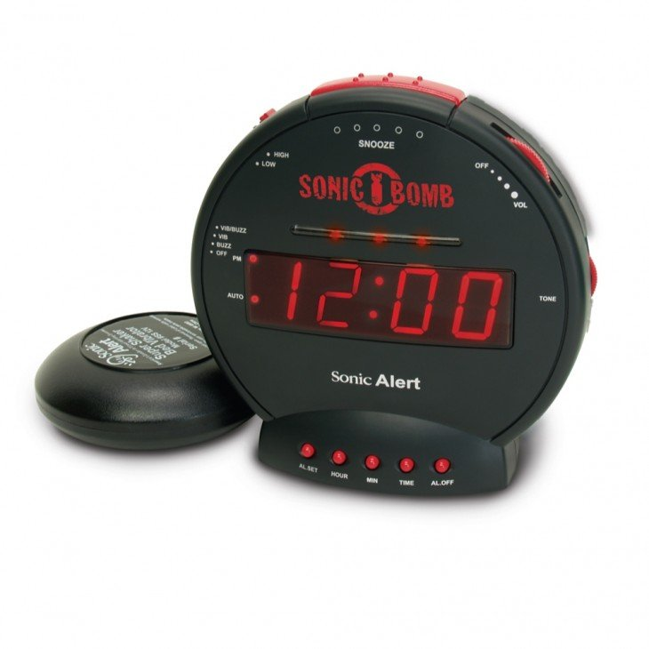 depertador en círculo negro con rojo que suena como si una bomba fuera a estallar