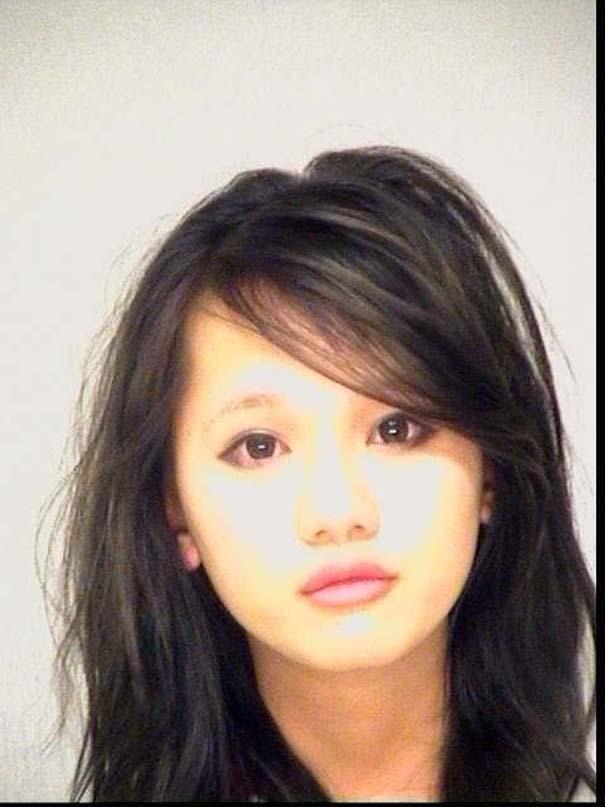 A tiny asian girl with a black giant az - 1 1