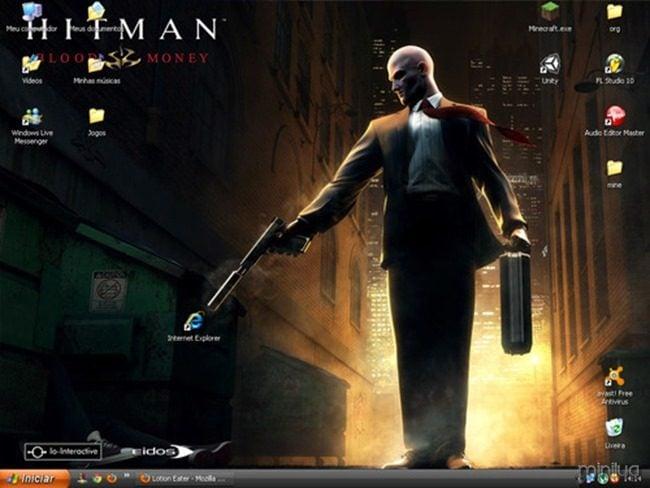 fondo de pantalla donde hitman esta a punto de disparar al icono de internet explorer