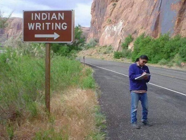 "hombre escribiendo a un costado de un letrero que dice 'Indian Writing"""