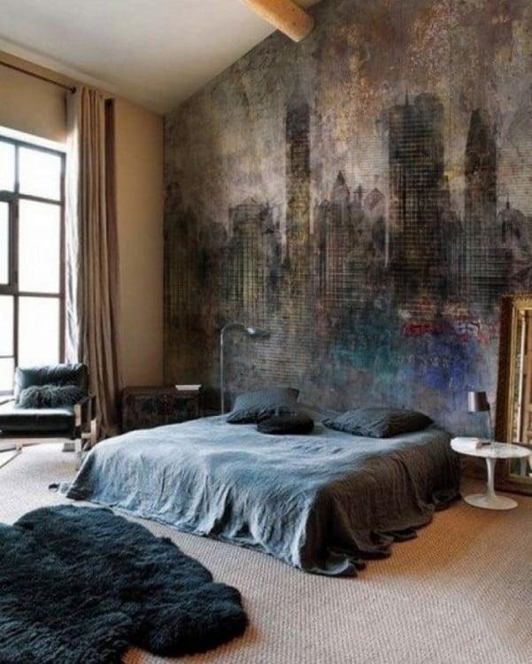 habitación con una cama y un mural de unos edificios en colores oscuros