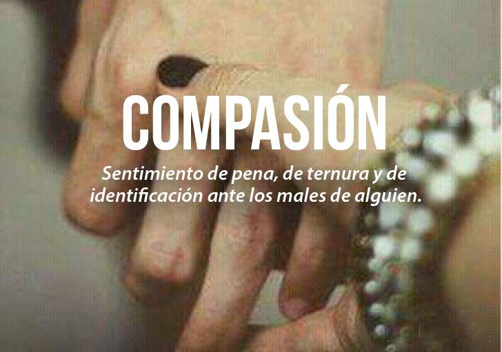manos de unas personas con la definición de compasión