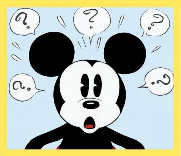 Cara de Mickey Mouse con muchos signos de interrogación alrededor de su cabeza