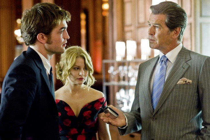 (Left to right) ROBERT PATTINSON, EMILIE DE RAVIN and PIERCE BROSNAN star in REMEMBER ME