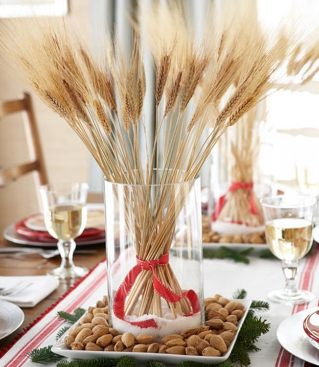 centro de mesa con frascos de vidrio con trigo en el centro
