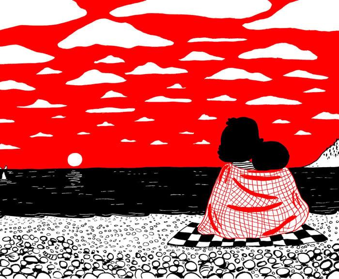 pareja abrazada viendo hacia el horizonte
