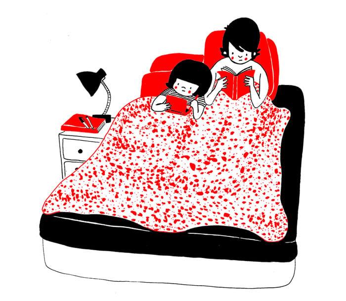 pareja leyendo en la cama