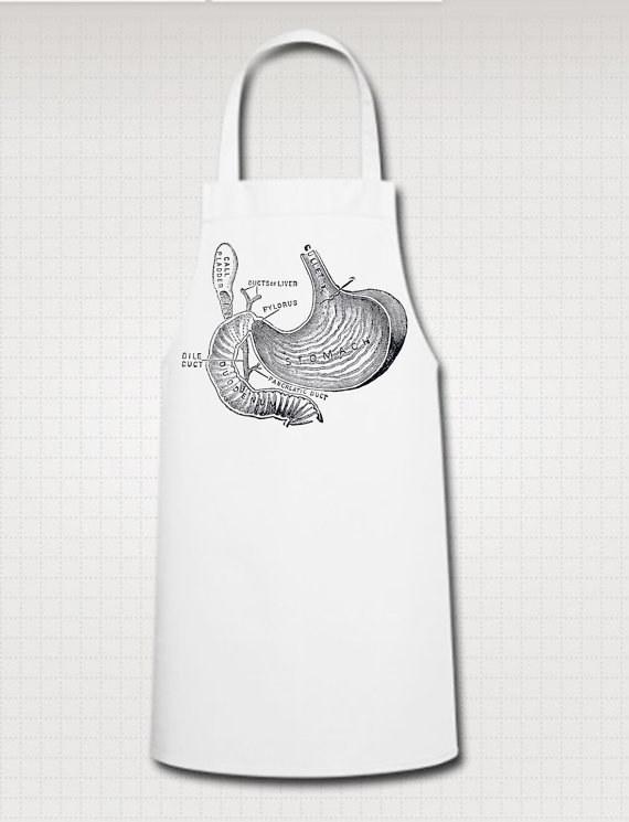 Delantal blanco con el diseño vintage de la anatomía del estómago