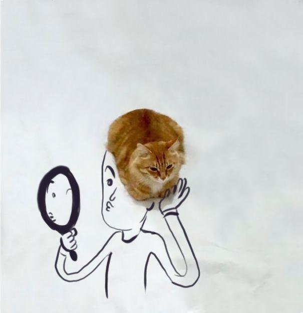 Gato sobre un dibujo de una persona donde simula ser su cabello