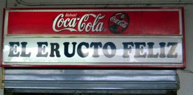 Letrero de coca cola con la frase EL ERUCTO FELIZ