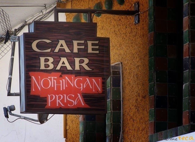Letrero de un cafe bar llamado: nothingan prisa