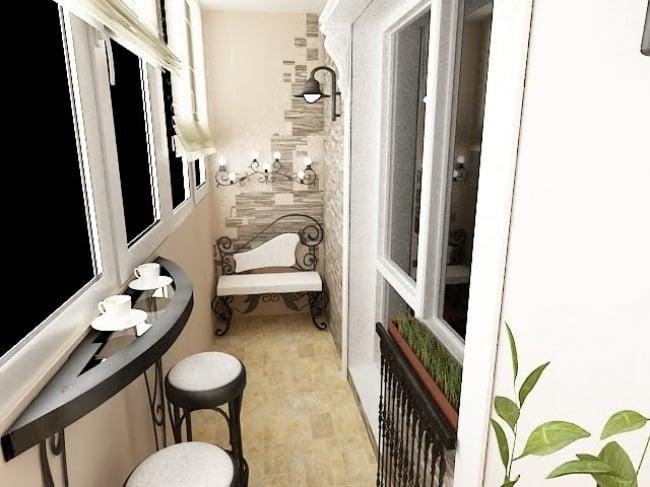 Balcón pequeño con mesa y bancos