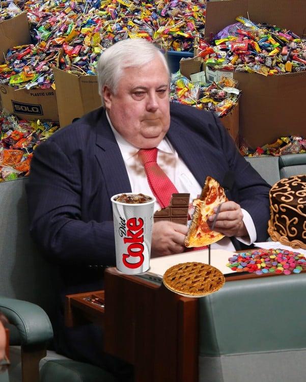phothosop de Clive Palmer en el parlamento comiendo y rodeado de muchas golosinas