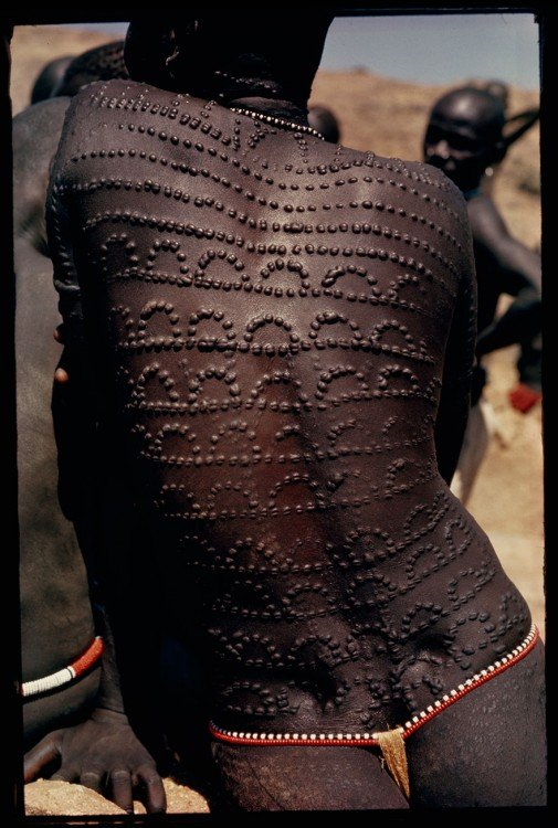 Welts, scars of beauty, pattern the entire back of a Nuba woman in Sudan, 1966.
