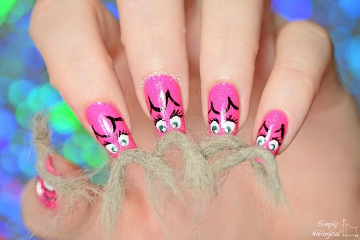 manos de una chica en color rosa con un poco de pelos en ellas