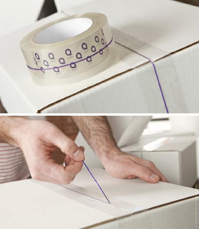 cinta adhesiva con una tira especial para desprenderse fácilmente