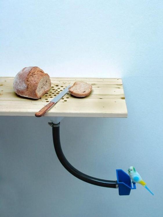 tabla para cortar 2 en 1 que sirve como contenedor para alimentar a tu pájaro