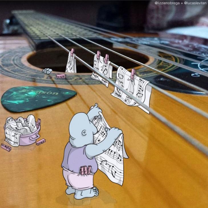 ilustraciones de algunos dibujos colgando algunas notas musicales sobre las cuerdas de una guitarra