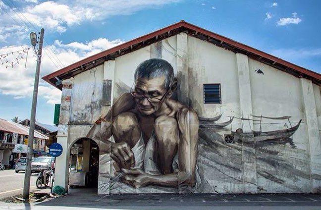 dibujo de un anciano pintado en una pared de Penang, Malaysia