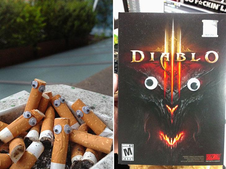 cigarros en un cenicero y una película de diablo con ojos de plástico