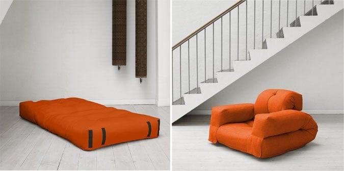 diseño de un sofá cama en color naranja cerca de unas escaleras