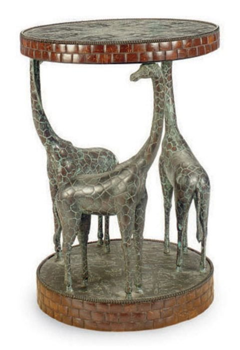 mesa con base de tres jirafas