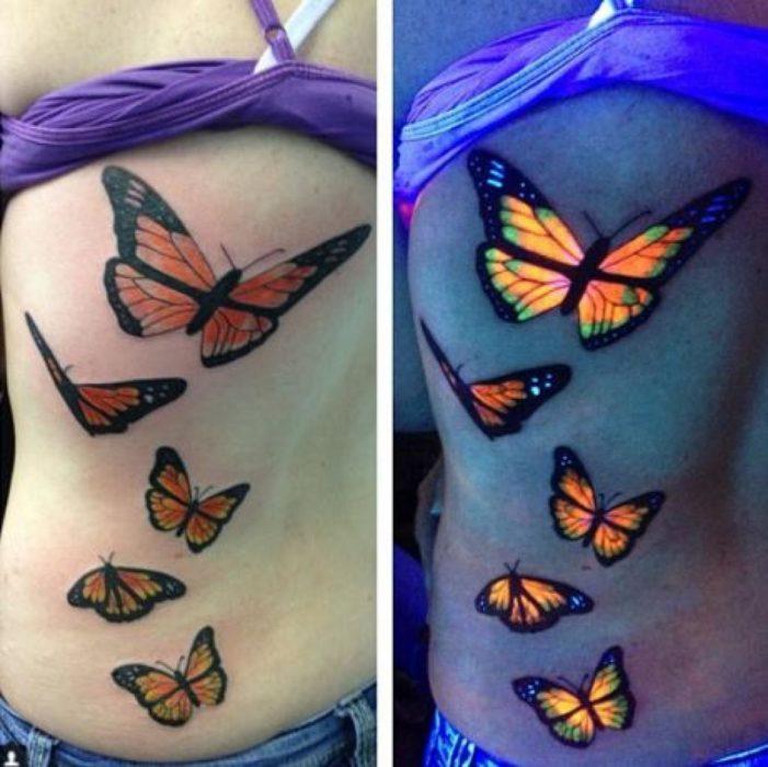 tatuaje con el diseño de mariposas que brillan en la oscuridad