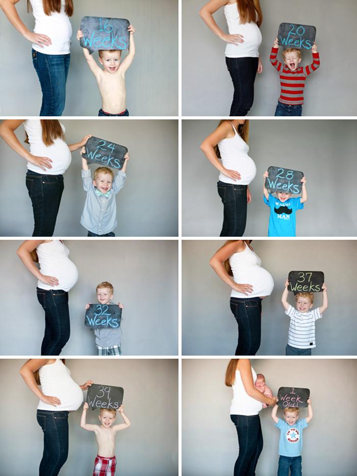 Mujer embarazada con letreros y niños