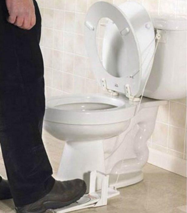 Soporte para evitar que caiga tapadera de baño
