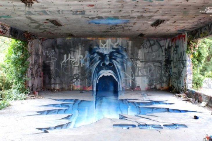 Graffitti de un hombre gritando y de su interiro sale agua