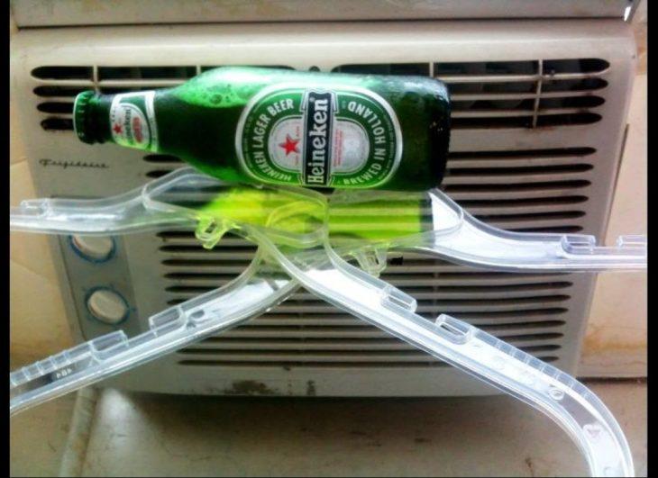 cerveza helada ganchos y aire acondicionado