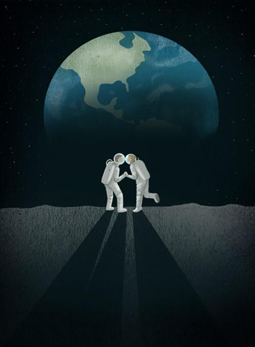 dos astronautas besándose