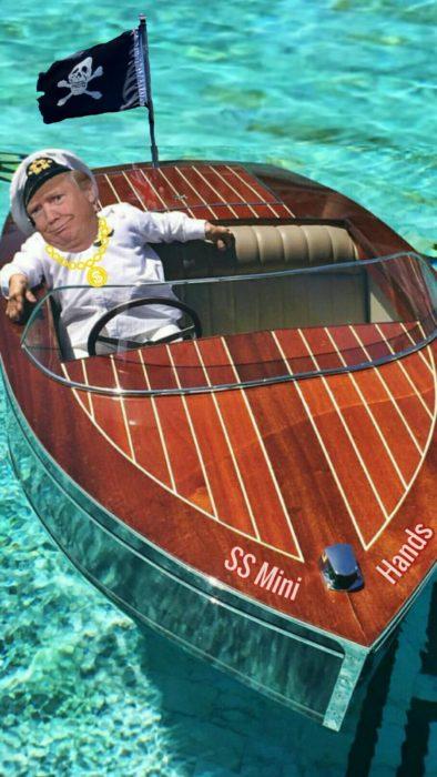 Batalla PS la cara de donald trump en un barco con una bandera de muerte