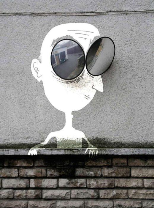 Arte en las calles de París - hombre con lents