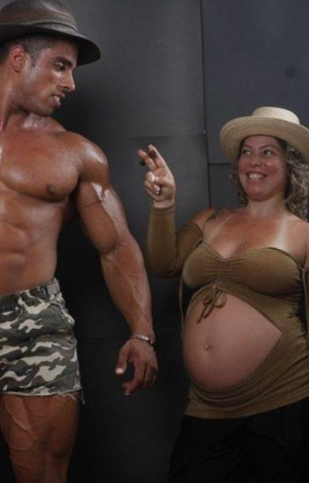Las peores fotos embarazo - Mujer embarazada le coquetea a hombre musculoso