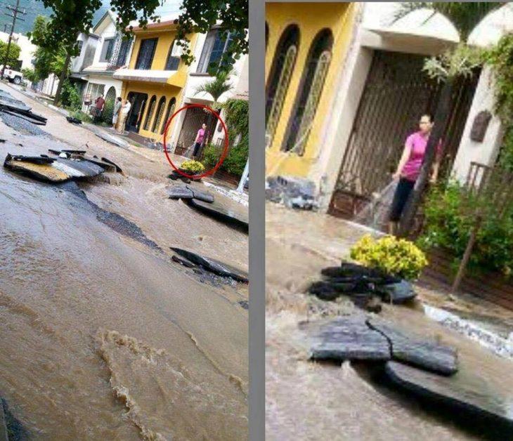 En plena inundación una mujer está regando la calle