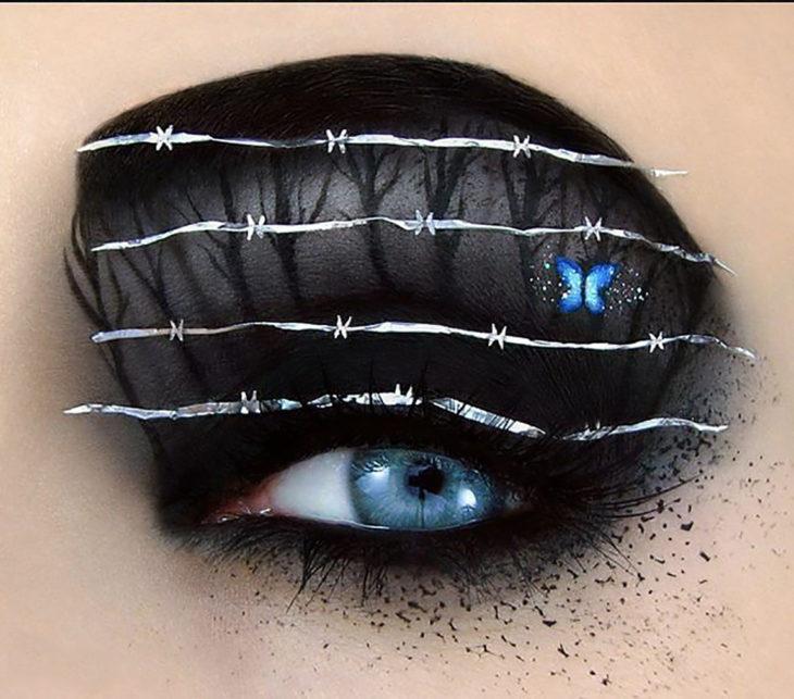 maquillaje de ojos Mariposa detrás de alambrado de espinas