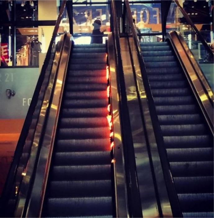 escalera eléctrica incendiándose
