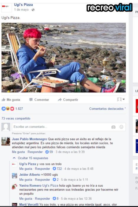 chico con el pelo rojo en una playa comiendo pizza ugi's
