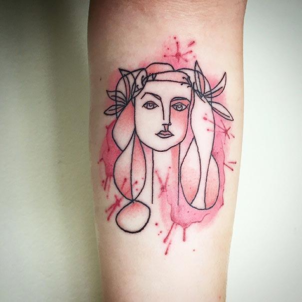Tatuaje inspirado en Picasso - rostro chica con rosa