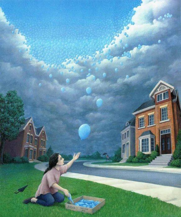 Niña jugando con globos