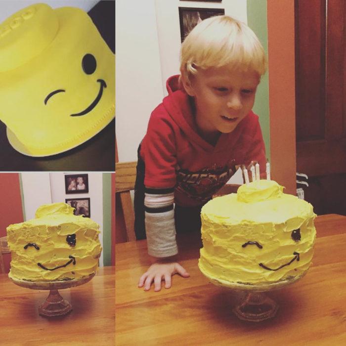 niño soplando su pastel de cumpleaños