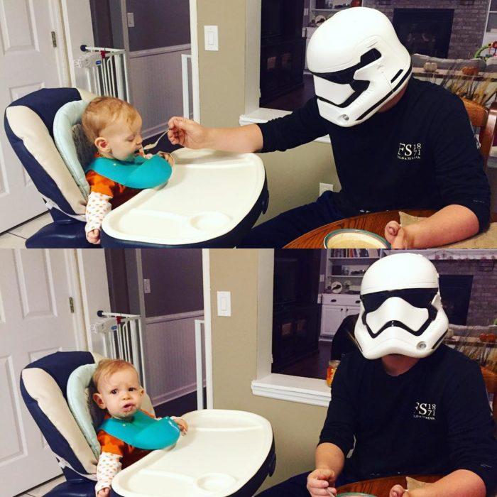 hombre con máscara de star wars alimentando a su hijo