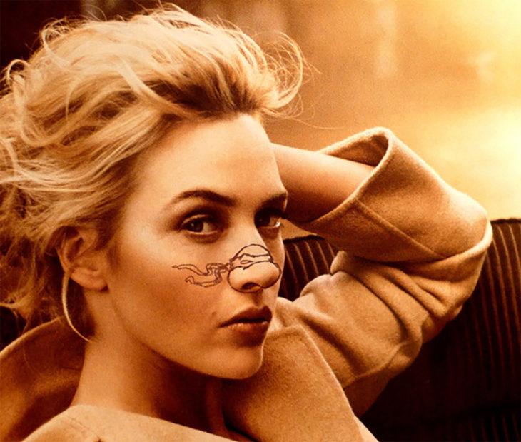 Kate Winslett con una tortuga dibujada en la nariz