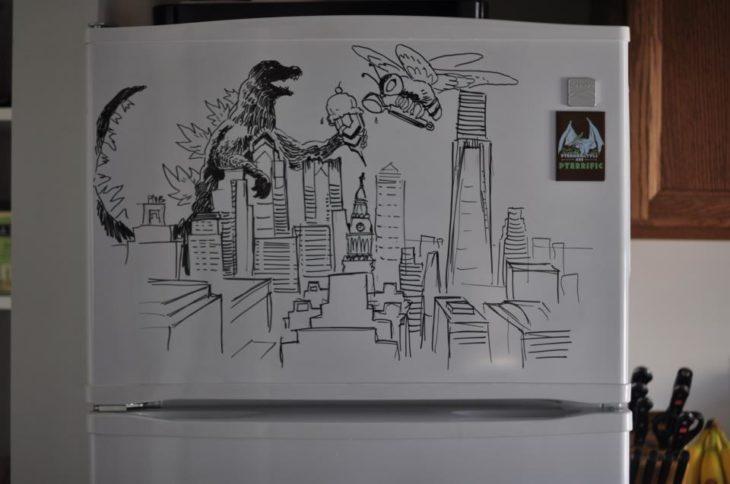 dibujo de godzila atacando la ciudad