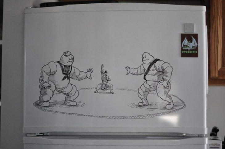 Dibujo realizado con plumón en el refirgerador