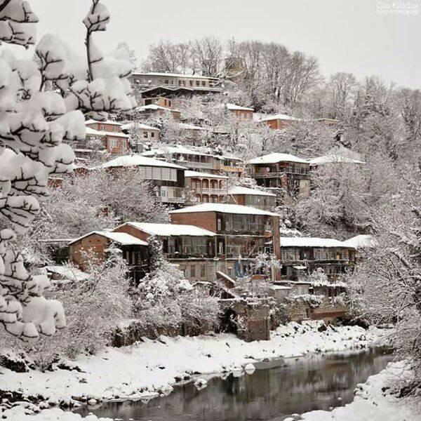 Postal de una ciudad nevada
