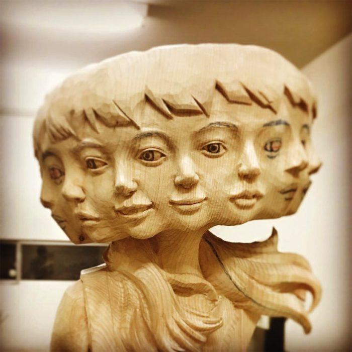 escultura de mujer con muchos rostros