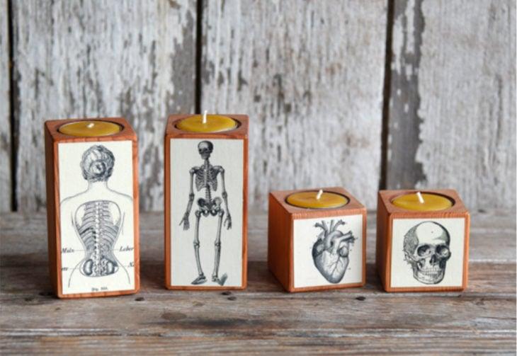 veladoras con ilustraciones de anatomía